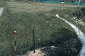 Land Surveyor Using Pole For Measuring Ground Control Point. Metal Survey Peg. poster