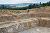 Opencast Mining Quarry With Lots Of Machinery. Mining In The Granite Quarry. Working Mining Machine  poster