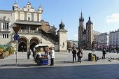 Market Place With Cloth Hall And St. Marys Church In Krakow In Poland