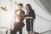 Business Woman And Man Holding Tickets In Airport. Checking Tickets While Aircraft Flying. Airport,  poster
