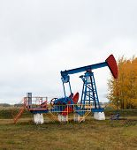 picture of nonrenewable  - One pump jacks on a oil field - JPG