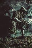 Nuclear Post-apocalypse Survivor In Gas Mask And Ghillie Cape, Sneaking In Deep Underground Tunnel O poster