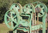 foto of wine-press  - Old farm machinery used for pressing grapes in the manufacture of wine - JPG