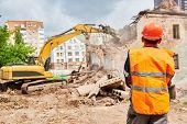 excavator crasher machine at demolition on construction site poster
