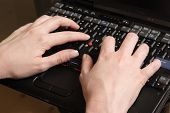 Woman's Hand Typing On Laptop