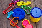 Playing With Bright Colourful Clay Dough (plasticine) On Wooden Background