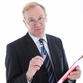 Businessman With Pen Emphasising A Point