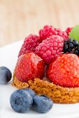 close up of fruit tart with berries