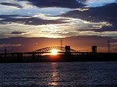 image of skyway bridge  - Sunsetting through the Burlington Skyway and Hamilton Lift bridge - JPG