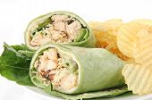 pic of sandwich wrap  - Closeup of a chicken ceasar wrap sandwich with chips - JPG