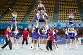 MOSCOW - MAR 24: Girls-participants of cheerleaders team Jam perform during Championship and Contest