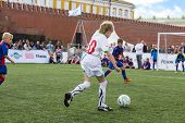 MOSCOW - MAY 26: Young players are playing soccer on VIII Forum Ready for Labor and Defense on May 2