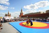 MOSCOW - MAY 26: The young fighters are locked in Mongolian wrestling on VIII Forum Ready for Labor