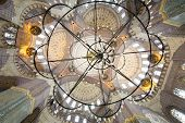 Grand, beautiful dome and chandelier in New Mosque (Yeni Cami) in Istanbul, Turkey. Mosque was built in years 1597-1663.