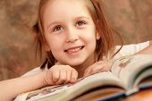stock photo of girl reading book  - Smart girl reading a book and learns - JPG