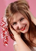 Cute Woman With Ribbon On Her Hair