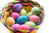 A Dozen Easter Eggs In An Easter Basket