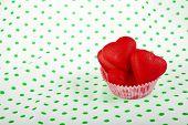 Sweet Marzipan heart candy on retro Vintage polka dot napkin background