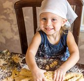 Child Knead The Dough In A Kerchief