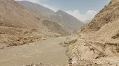stock photo of karakoram  - The raging Indus River in Northern Pakistan - JPG