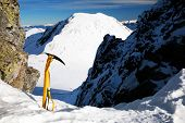 Ice axe - alpine background