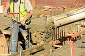 image of chute  - Pouring a foundation for a new commercial building in Roseburg Oregon - JPG