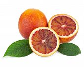 image of valencia-orange  - Ripe red blood oranges with cut and green leaves isolated on white background - JPG