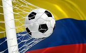 Colombia Waving Flag And Soccer Ball In Goal Net