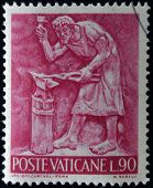 A stamp printed in Vatican shows Bas reliefs of arts and crafts blacksmith