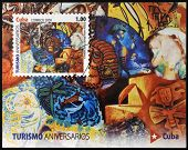 stamp dedicated to tourism shows mural by several artists in the Hotel Inglaterra