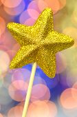 christmas decoration, golden brocade star against bokeh background