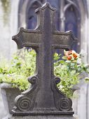 foto of tombstone  - old nameless tombstone in cemetery setting shallow depth of field - JPG