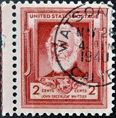 UNITED STATES OF AMERICA - CIRCA 1940: A stamp printed in USA shows John Greenleaf Whittier