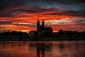 Cathedral Of Magdeburg And The River Elbe At Sundown