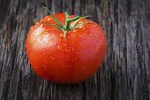 Organic Tomato With Water Droplets Closeup