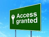 Protection concept: Access Granted and Key on road sign background