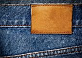Old Jeans Texture With Leather Label Background Close Up