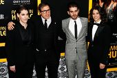 NEW YORK-DEC 8: (L-R) Megan Ellison, David O. Russell, Matthew Budman and guest attend the