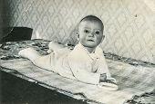 GANSERNDORF, AUSTRIA, CIRCA 1930s - Vintage photo of baby boy,  Ganserndorf, Austria, circa 1930s