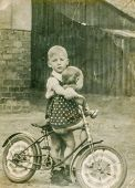 GANSERNDORF, AUSTRIA, CIRCA 1930s - Vintage photo of two brothers with a bike,  Ganserndorf, Austria, circa 1930s