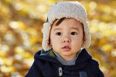 stock photo of down jacket  - Closeup portrait of little boy in jacket and fur cap - JPG