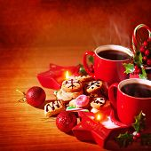 Closeup photo of festive Christmastime still life, tasty dessert, homemade cookie with mug of hot co