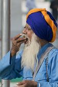 Aged Sikh Eating Offering