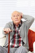 Disoriented demented old senior citizen man trying to remember