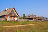 Row Of Traditional Wooden Houses In A Remote Village In Russian Siberia
