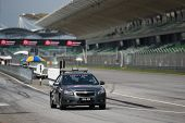 SEPANG, MALAYSIA - MAY 11, 2014: The Sepang International Circuit Safety Car enters the track at the
