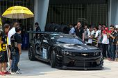 SEPANG, MALAYSIA - MAY 11, 2014: Tomas Enge in a Chevrolet Camaro GT3 car leaves for the tracks to s