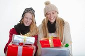 teens with wrapped gifts for christmas or holiday party