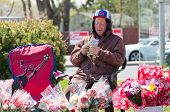 Canadian Senior Citizen Selling Flowers On Mother's Day