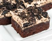 stock photo of chocolate fudge  - Cookies and cream brownies with topping made from Oreo cookies - JPG